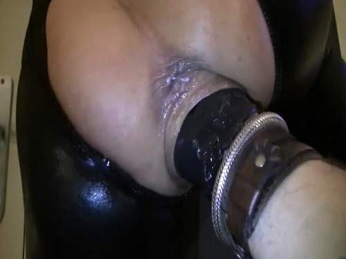 Hand with rubber glove fully penetration in squirting cunt