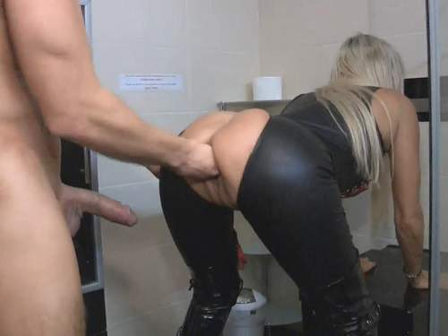 Mistress gets fisted in different poses in the bathroom