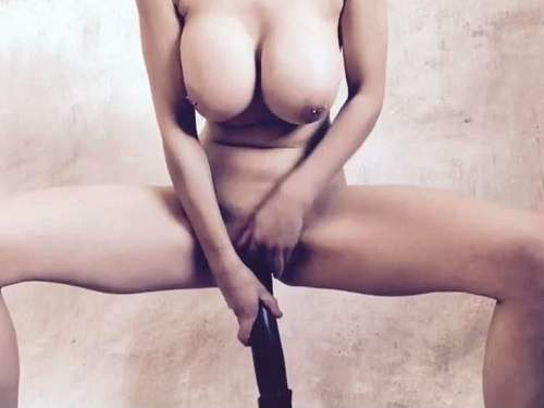 Webcam – Busty milf with piercing nipples rides on a monster black dildo